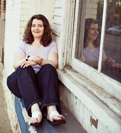 Jennette sits in a window. (Photo by Kyle Hepp)