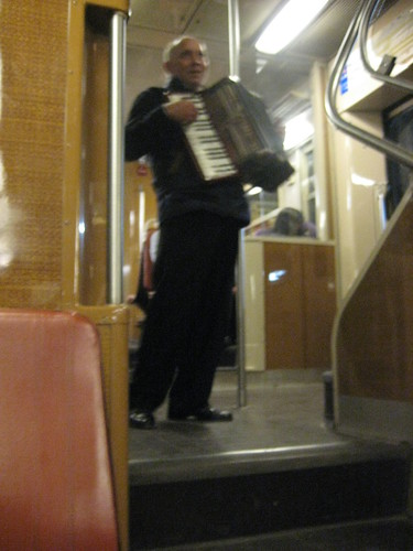 Accordion player on train